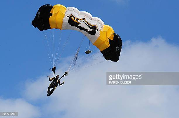 Army Sgt Vance van der Maarel of the 101st Airborne Division Screaming Eagle Parachute Demonstration Team drops from the sky during ceremonies on...
