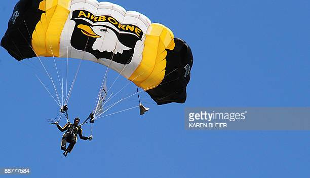 Army Sgt. Vance van der Maarel of the 101st Airborne Division Screaming Eagle Parachute Demonstration Team drops from the sky carrying the US flag...