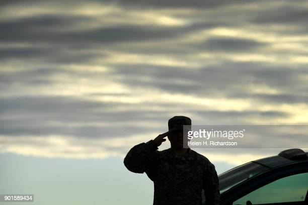 Army Sgt William GarciaMayen salutes as the funeral procession for Douglas County sheriff's deputy Zackari Parrish passes by on northbound on Highway...