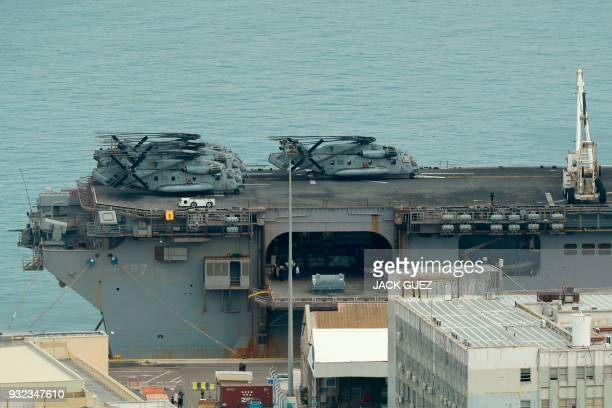 US army Sikorsky CH53E Super Stallion are resting on the bridge of US Navy's Waspclass amphibious assault ship USS Iwo Jima anchored in the northern...