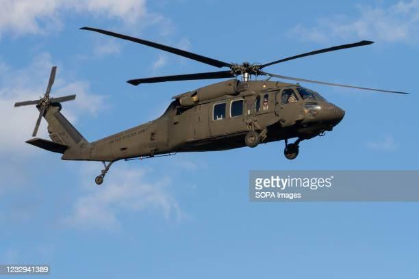 Army Sikorsky UH-60 Black Hawk helicopter prepares to land at Naval Air Facility in Kanagawa.