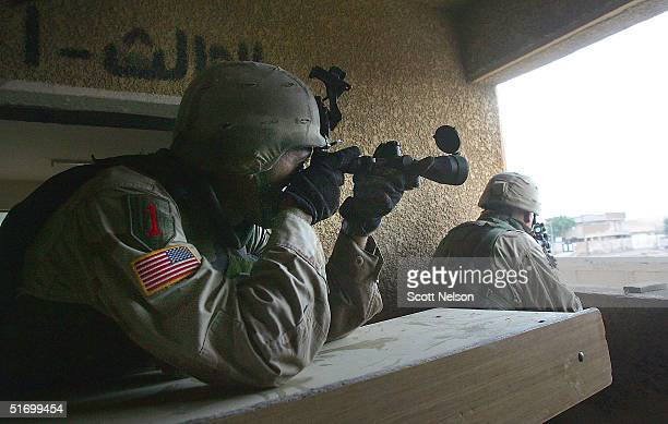 S Army snipers from the 1st Infantry Division's 2nd Battalion2nd Regiment try to locate enemy positions during heavy fighting November 9 2004 in the...