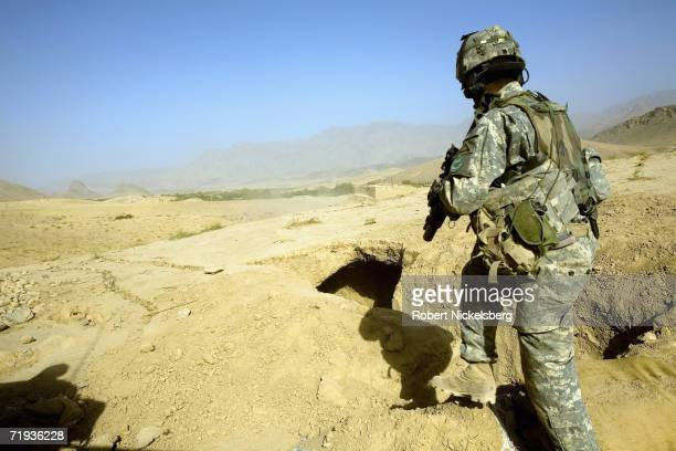 Army soldier checks a possible Taliban fighting position outside the Forward Operating Base Mizan in Zabul Province, Afghanistan September 15, 2006....