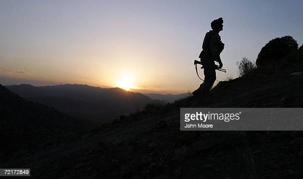 S Army soldier climbs a hill towards an American outpost October 15 2006 near Camp Tillman Afghanistan just two kilometers from the Pakistan border...