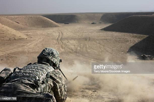 A U.S. Army soldier fires a Barrett M82A1 rifle on a firing range, Kunduz, Afghanistan.
