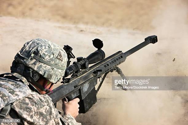 A U.S. Army soldier fires a Barrett M82A1 rifle on a range, Kunduz, Afghanistan.
