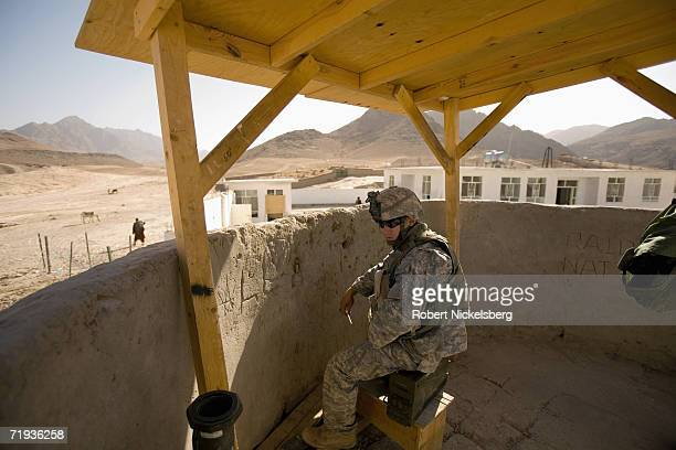 Army soldier from C Company, 1-4 Infantry Regiment mans a guard tower at the Forward Operating Base Mizan in Zabul Province, Afghanistan September...