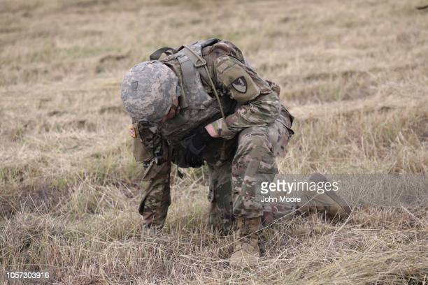 S Army soldier from Ft Riley Kansas pauses from the heat while stringing razor wire near the port of entry at the USMexico border on November 4 2018...