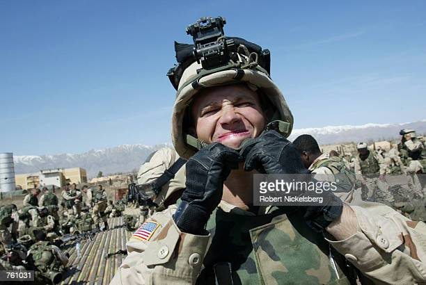 A US army soldier from the 10th Mountain Division get ready to board a Chinook helicopter during Operation Anaconda at Bagram Air Base March 13 2002...