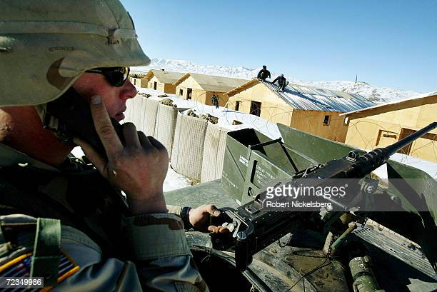 A US Army soldier from the 3rd Battalion 321st Field Artillery Regiment speaks on his walkie talkie during a Quick Reaction Force exercise inside the...