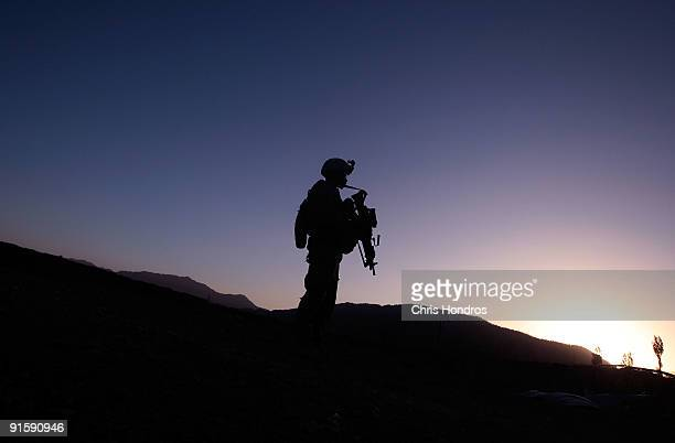 S Army soldier in the 3/509 of the 25th Infantry Division patrols at sunrise October 8 2009 in Dabay Afghanistan Dabau is a desperately poor agrarian...