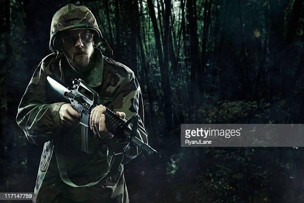 Army Soldier In Vietnam Jungle with Gun