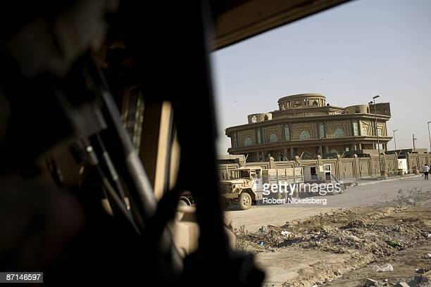 Army soldier left prepares to exit his Mine Resistant Ambush Protected vehicle outside an Iraqi Army command post in Sadr City the 25 million Shia...