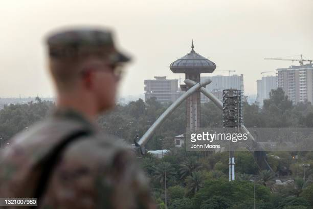 Army soldier looks onto Baghdad and the Saddam-era Crossed Sabers monument from the International Zone on May 30, 2021 in Baghdad, Iraq. Coalition...