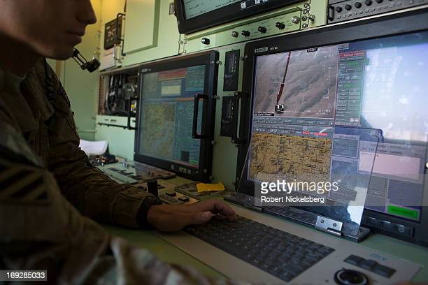 Army soldier monitors a US Army 14' Shadow surveillance drone from a control room after it's launched at Forward Operating Base Shank May 8, 2013 in...