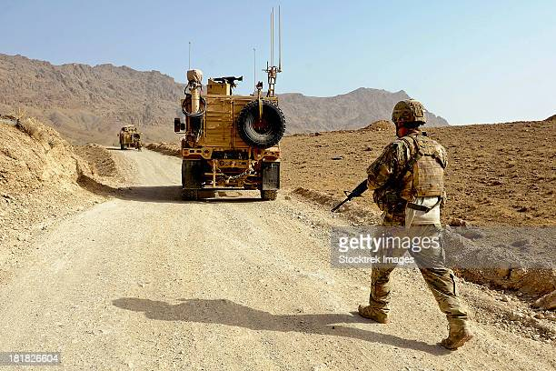 U.S. Army soldier moves to his MRAP vehicle in Afghanistan.
