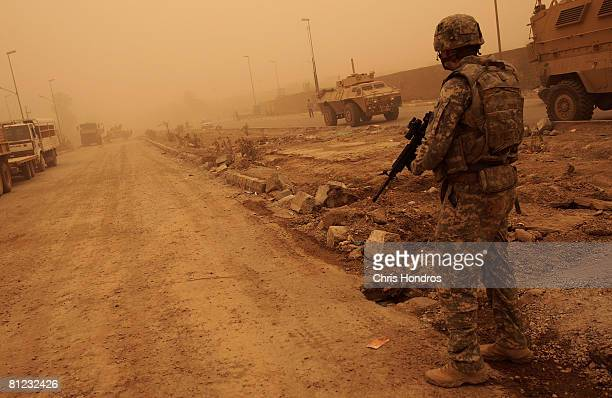 S Army soldier of the 3rd Brigade Combat Team of the 4th Infantry Division patrols in a deserted market area that recently saw heavy fighting May 25...