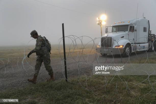 S Army soldier opens a gate while on guard duty near the USMexico border on November 5 2018 in Donna Texas Troops had set up razor wire there in...