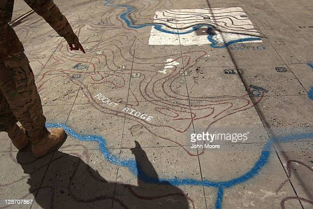 S Army soldier points out Taliban fighting positions on a topographical map at Forward Operating Base Bostick on Sept 4 2011 in the Kunar Province of...