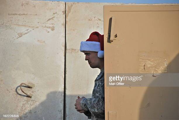 Army soldier prepares for Christmas dinner at his outpost in downtown Baghdad.