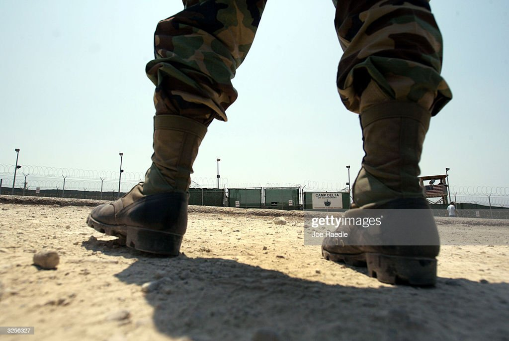 S. Army soldier stands across from the entrance to Camp Delta where detainees from the U.S. war in Afghanistan live April 7, 2004 in Guantanamo Bay, Cuba. On April 20, the U.S. Supreme Court is expected to consider whether the detainees can ask U.S. courts to review their cases. Approximately 600 prisoners from the U.S. war in Afghanistan remain in detention.