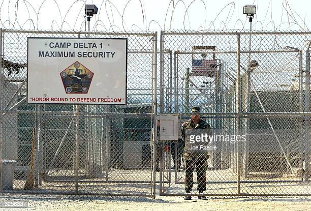 Army soldier stands at the entrance to Camp Delta where detainees from the U.S. War in Afghanistan live April 7, 2004 in Guantanamo Bay, Cuba. On...