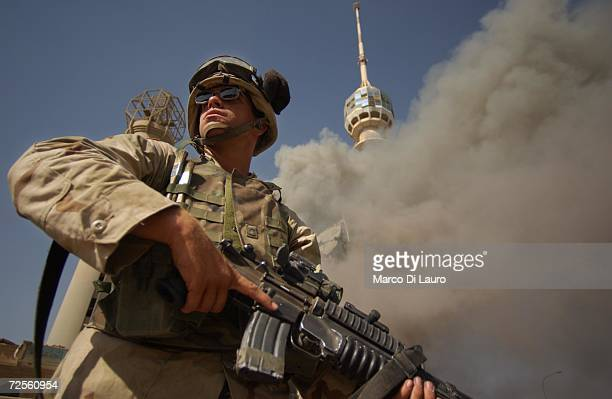 Army soldier stands by the burning Saddam Communication Tower Complex May 24 2003 in Baghdad Iraq This is the third time the complex has been the...