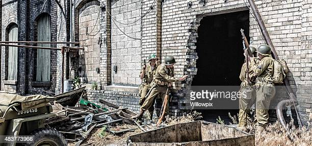 WWII US Army Soldier Throwing Hand Grenade Into Building