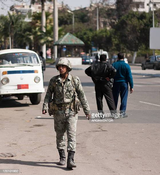 Army soldier walking the streets of Cairo