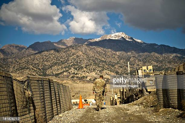 U.S. Army soldier walks down a path at Combat Outpost Herrera.