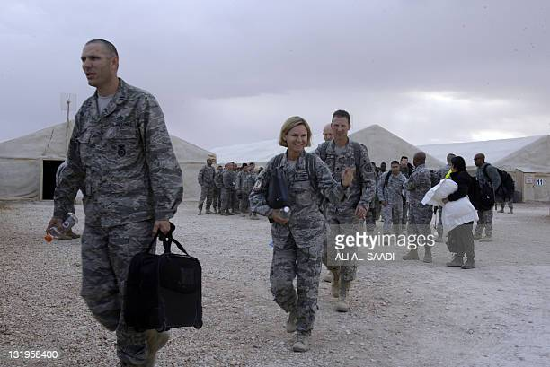 A US army soldier waves as her reginment prepares to fly out of Iraq on their way home from the alAsad Air Base west the capital Baghdad on November...