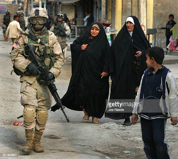 S Army soldier with the 1st Cavalry Task Force 19 walks through the streets on patrol February 11 2005 in the Haifa Street neighborhood of Baghdad...