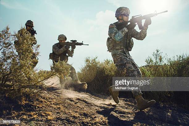 army soldiers advancing in combat. - army soldier stock pictures, royalty-free photos & images