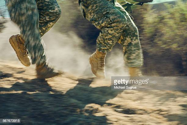 Army soldiers advancing in combat.