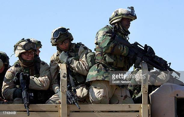 S Army soldiers are transported by truck to January 24 2003 exercises near the Iraqi border in Kuwait The US military continues to ready its' forces...