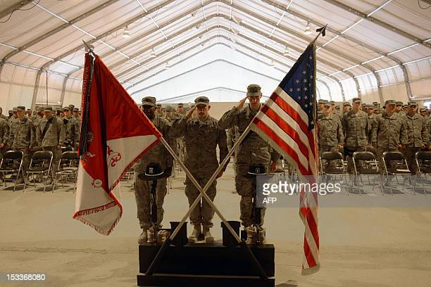 US Army soldiers attached to the 1st Squadron 91st US Cavalry Regiment 173D Airborne Brigade Combat Team soldiers pay their respect by the boots gun...