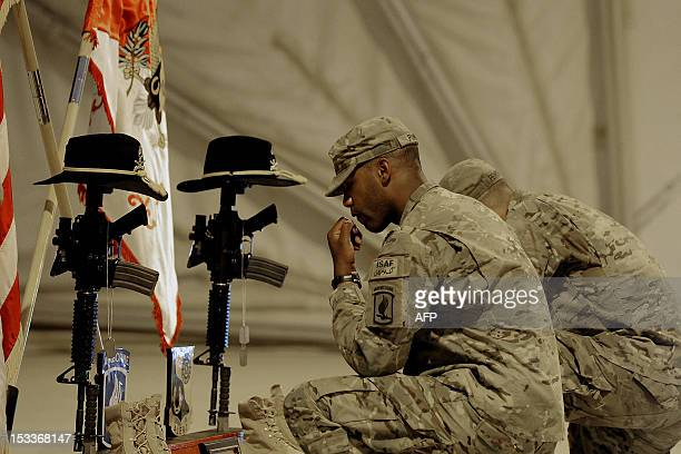 US Army soldiers attached to the 1st Squadron 91st US Cavalry Regiment 173d Airborne Brigade Combat Team soldiers pay their respects by the boots gun...
