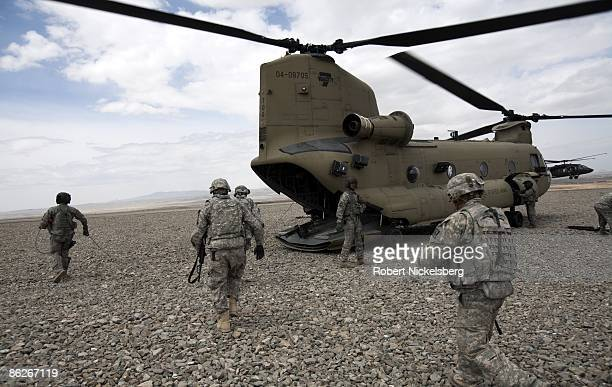Army soldiers board a US Army CH47 Chinook helicopter at a Forward Operating Base in Paktia province south central Afghanistan April 10 2009 With...