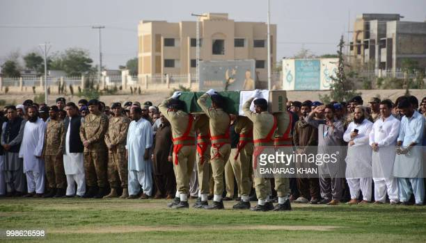 Army soldiers carry the coffin of Siraj Raisani a candidate of provincial seat who was killed in Mastung bomb blast during his funeral in Quetta on...