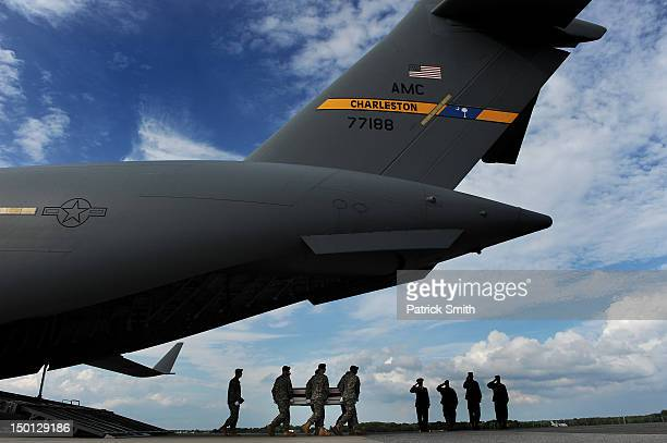 S Army soldiers carry the flagdraped transfer case containing the remains of US Army Maj Thomas E Kennedy during a dignified transfer at Dover Air...