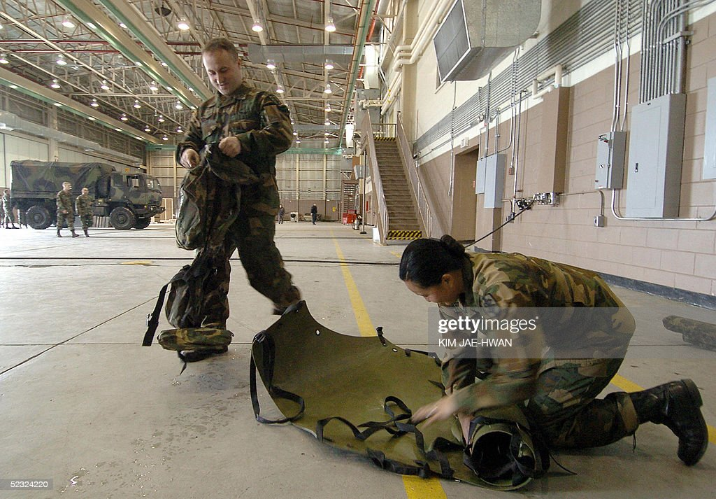 US army soldiers check medical gear in Camp Page, a key
