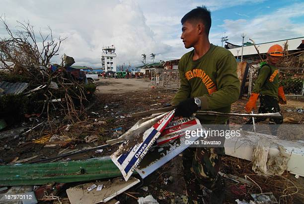 Army soldiers clear debris in Tacloban City Airport on November 14 2013 in Tacloban Philippines Typhoon Haiyan which ripped through Philippines over...
