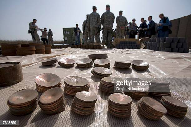 S Army soldiers display a large weapons cache of deadly armorpiercing bombs of a type Tehran has allegedly smuggled to Shiite militias February 26...