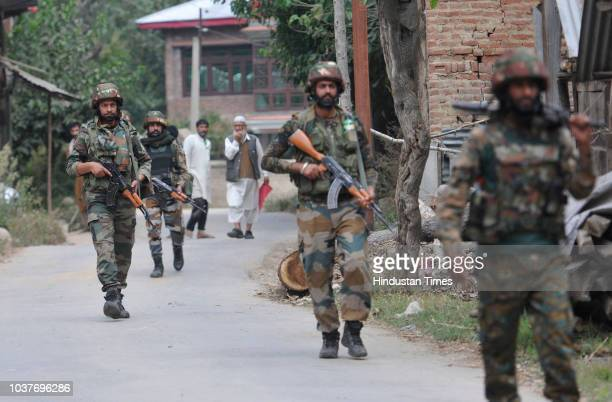 Army soldiers during a cordonandsearch operation at Lassipora in Pulwama village some 40 kilometres south of Srinagar on September 22 2018 Forces on...
