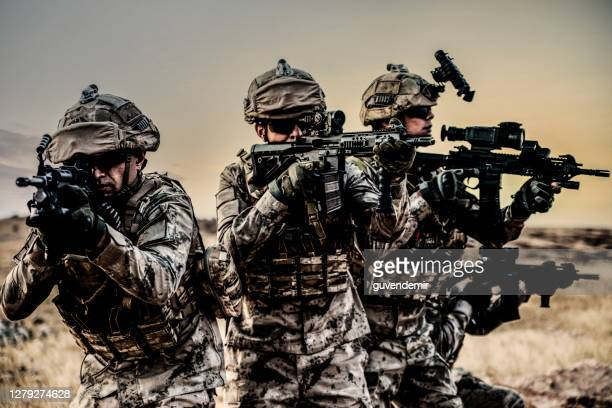 army soldiers fighting scene on war with sunset background - weaponry stock pictures, royalty-free photos & images