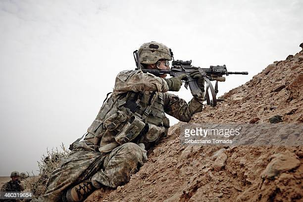 Army soldiers from 1st Battalion 320th Field Artillery Regiment 2nd Brigade Combat Team of the 101st get in to fighting positions during a firefight...