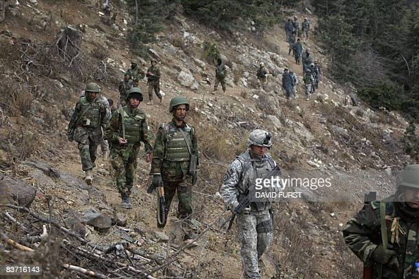 Army soldiers from 2-506 Infantry 101st Airborne Division and Afghan National Army soldiers patrol through the Spira mountains in search of...