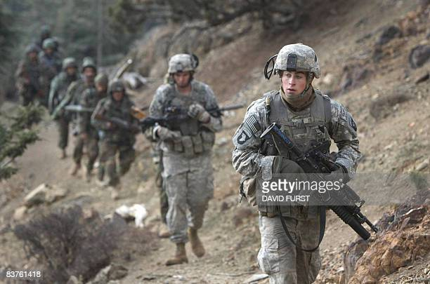 Army soldiers from 2-506 Infantry 101st Airborne Division and Afghan National Army soldiers patrol through the Spira mountains for insurgents during...