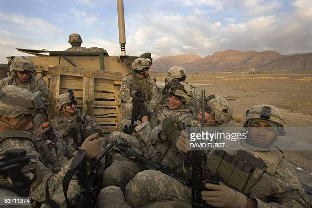 Army soldiers from 2-506 Infantry 101st Airborne Division are transported on a flatbed truck to a helipad to set off on day one of Operation Radu...