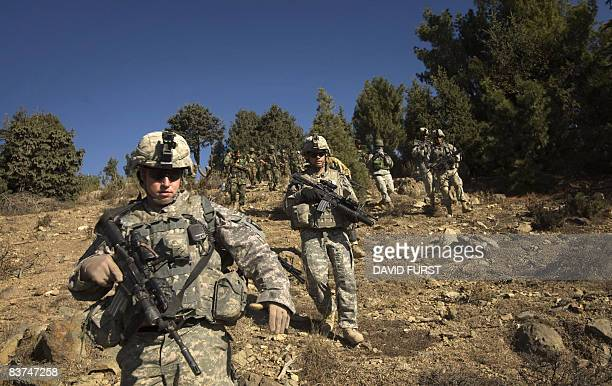 Army soldiers from 2-506 Infantry 101st Airborne Division patrol through the Spira mountains in search of insurgents during day two of Operation Radu...